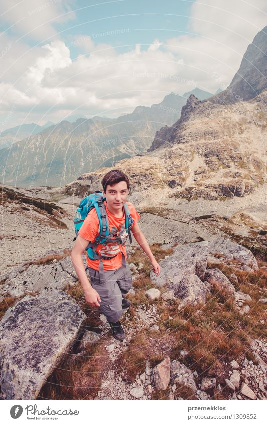 Boy hiking in the Tatra Mountains Vacation & Travel Trip Adventure Hiking Young man Youth (Young adults) 1 Human being 13 - 18 years Rock Joy hiker Colour photo