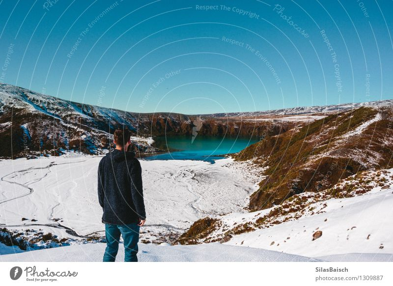Staring on a Mountain Lake in New Zealand Human being Nature Vacation & Travel Youth (Young adults) Man Landscape Joy Far-off places 18 - 30 years Winter Cold Adults Mountain Snow Freedom Rock