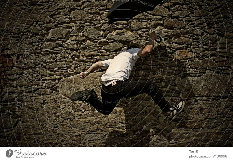 Man White Vacation & Travel Joy Black Wall (building) Jump Wall (barrier) Stone Legs Brown Arm Speed Happiness T-shirt Umbrella
