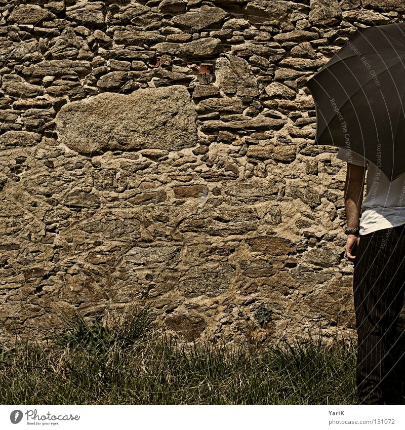 gate Umbrella Man T-shirt White Black Brown Stony Wall (building) Wall (barrier) Stone wall Plaster Drop shadow Happiness Cheerful Joie de vivre (Vitality)