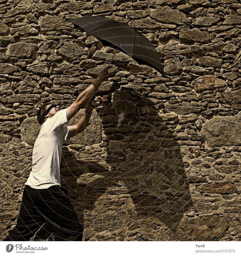 rockfall Umbrella Man T-shirt White Black Brown Stony Wall (building) Wall (barrier) Stone wall Plaster Drop shadow Happiness Cheerful Joie de vivre (Vitality)