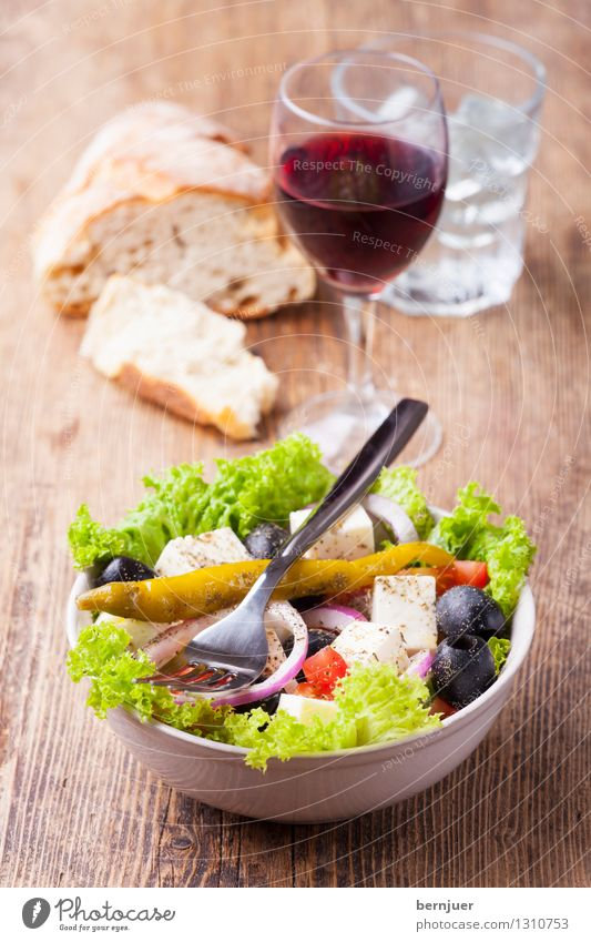 Greek salad Food Lettuce Salad Bread Nutrition Vegetarian diet Beverage Drinking Drinking water Wine Bowl Cutlery Fork Cheap Good Red wine Wine glass Tumbler