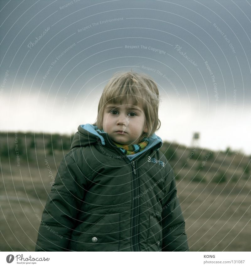 sussed Small Dwarf Child Toddler Goblin Sweet Raincloud Vista Looking Skeptical Portrait photograph Close-up Concentrate cute threatening sky Weather