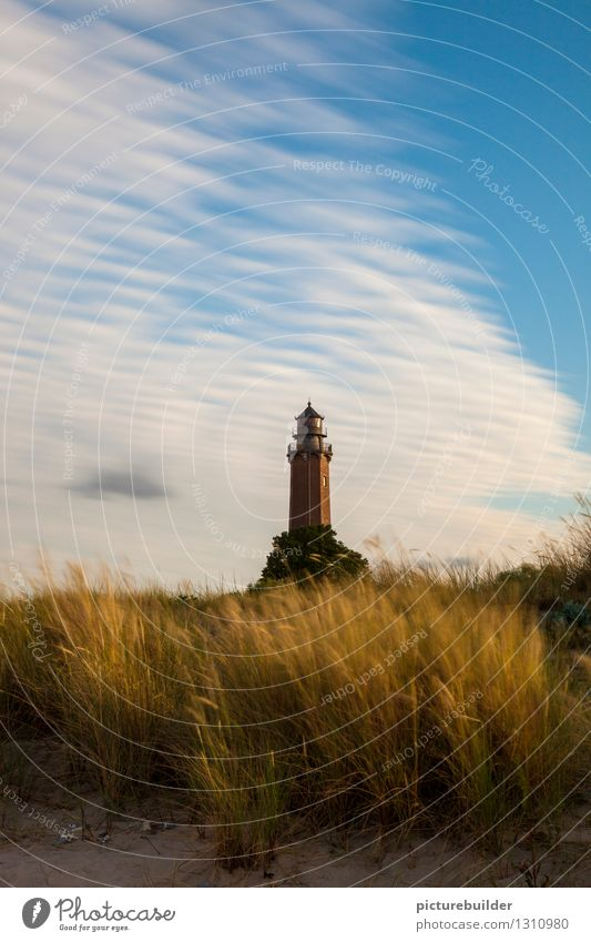 Lighthouse in the evening light Tourism Summer Beach Coast Baltic Sea Ocean Deserted Road sign Blue Gold Hope Trust Colour photo Exterior shot Copy Space top