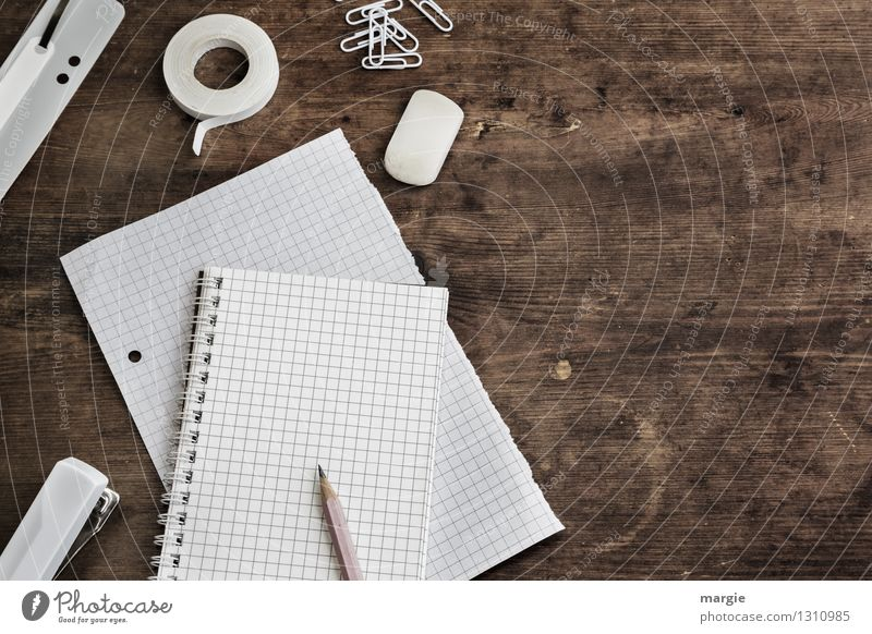 White paper, pen, paper clips, eraser, stapler on an old wooden desk Table Profession Office work Workplace Trade Logistics Business To talk Stationery Paper