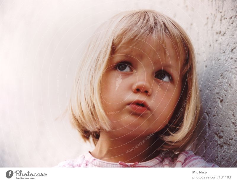 Child Beautiful Girl Face Wall (building) Emotions Hair and hairstyles Wall (barrier) Blonde Mouth Sweet Cute Peace Toddler Plaster Facial expression