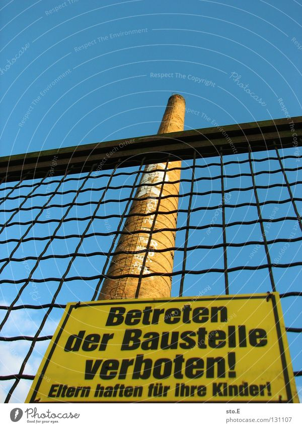 Sky Blue Signs and labeling Tall Closed Industry Broken Construction site Tower Sign Derelict Signage Fence Beautiful weather Chimney