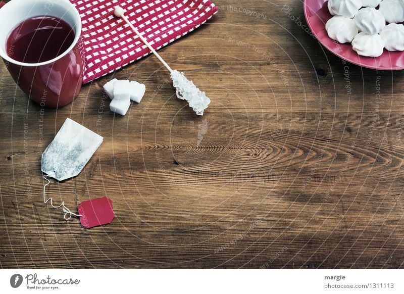 Red tea with sugar and cookies on a wooden table Cake Dessert Candy Teabag Sugar Baked goods Beverage Hot drink Plate Cup Napkin Lifestyle Healthy Harmonious