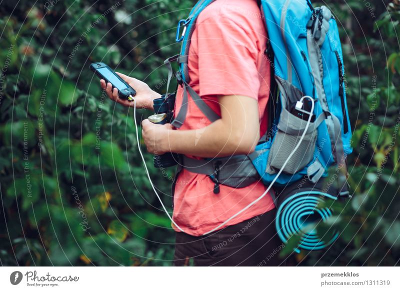 Charging mobile phone during the journey Vacation & Travel Trip Adventure Hiking Cellphone Cable Young man Youth (Young adults) 1 Human being 13 - 18 years