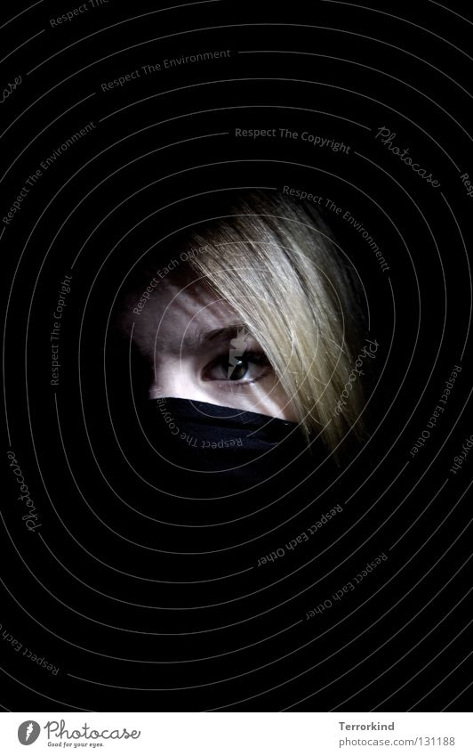 Terrorism.as.of.today.only.with.sword. Young woman Face of a woman Blonde Strand of hair Looking into the camera Low-key Copy Space top Copy Space bottom