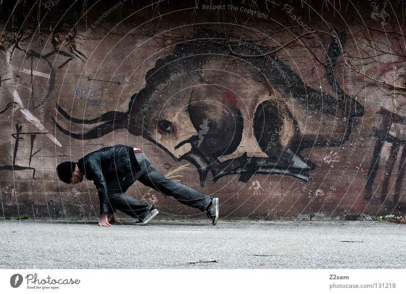 Human being Man City Animal Dark Wall (building) Graffiti Style Brown Together Walking Concrete Beginning Cool (slang) Jeans Painting and drawing (object)