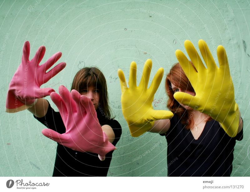two women with gloves Gloves Rubber Pink Yellow Gaudy Intoxicant Turquoise Wall (building) Hand Dirty Cleaning Noble Whimsical Strange Carnival Obscure Fingers