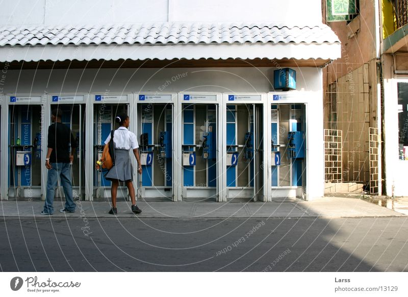 Human being To talk Couple In pairs Lesser Antilles Telephone Phone box Castries St. Lucia