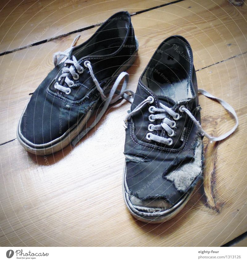 What was left of wearing it Lifestyle Going out Feet Footwear Sneakers Footprint Fight Walking Old Poverty Cheap Hideous Hip & trendy Nerdy Stress Uniqueness