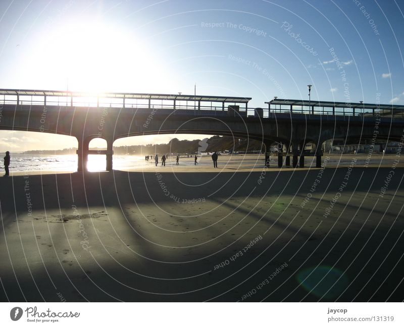 Beach gate Human being Relaxation Sky Sunset Ocean sea morse sun clouds s&#322 o&#324 chmury ludzie Gate bridge blue