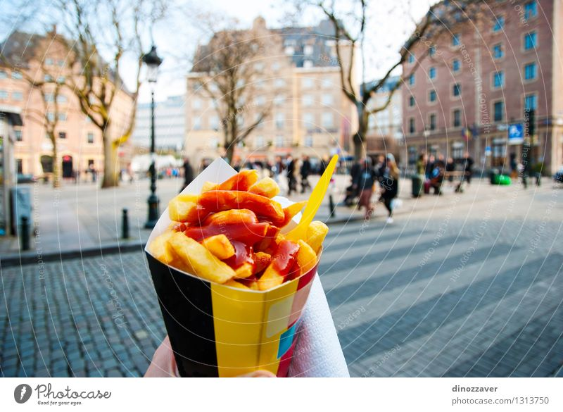 Belgian fries Lunch Fast food Tourism Restaurant Hand Tree Town Street Stand Yellow Gold Tradition frits chips Brussels Belgium Snack people french Potatoes