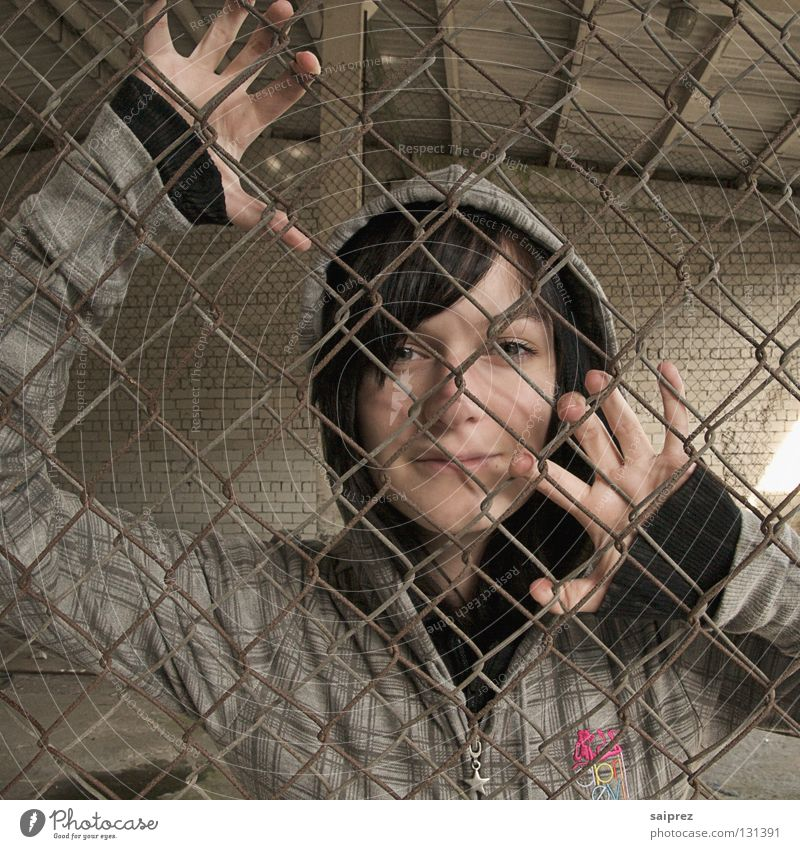 captive Woman Portrait photograph Fence Hand Wire netting fence Captured Enclosed Drift Escape Face Hooded (clothing) Shadow