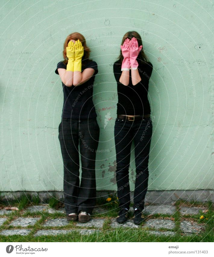 two women hiding behind rubber gloves Gloves Rubber Pink Yellow Gaudy Intoxicant Turquoise Wall (building) Hand Describe Dirty Cleaning Noble Whimsical Strange