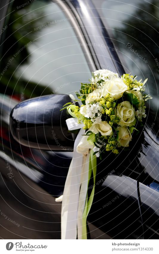 Flower decoration on a wedding car Wedding Motoring Driving Multicoloured bride celebrate celebration Chauffeur flowers rose looking marriage married mirror
