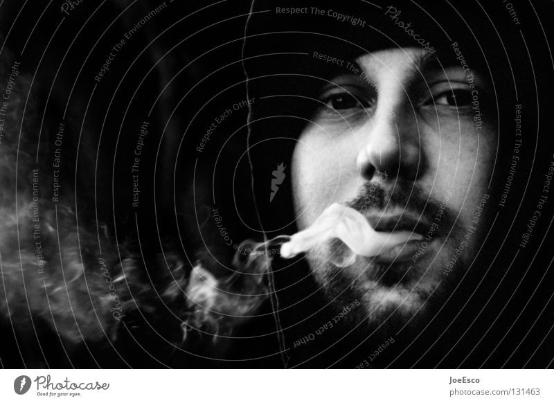 the melancholic smoker Lifestyle Smoking Contentment Calm Masculine Man Adults 1 Human being 18 - 30 years Youth (Young adults) Cap Designer stubble Beard Smoke