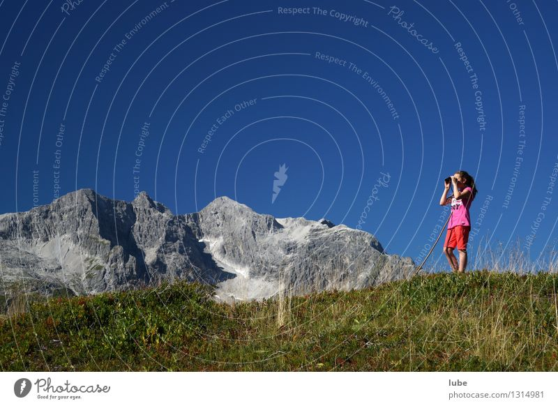 Anna is watching TV Girl 1 Human being 8 - 13 years Child Infancy Environment Nature Landscape Sky Summer Climate Weather Beautiful weather Rock Alps Mountain