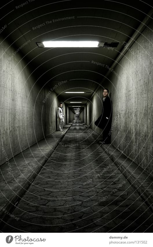 Endless Man Fellow Stand Tunnel Wall (building) Suit Infinity Light Curbside Sidewalk Night Dark White Black Subsoil Posture Long exposure Fluorescent Lights