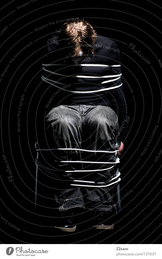 Human being Man Black Loneliness Dark Style Hair and hairstyles Fear Glittering Masculine Rope Sit Jeans Chair Simple Creepy