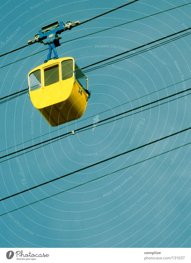 Yellow gondola Vacation & Travel Tourism Trip Freedom Sightseeing Snow Winter vacation Hiking Skis Rope Sky Cable car Above Blue gondola lift Wire cable Upward