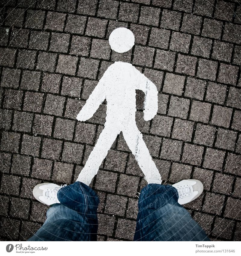 Man Lanes & trails Footwear Going Road traffic Transport Laws and Regulations Jeans Stand To go for a walk Pants Sign Sidewalk Signage Intersection Symbols and metaphors