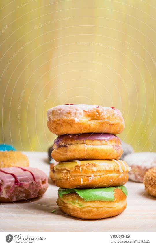 Freshly baked donuts with glaze Food Dough Baked goods Cake Dessert Nutrition Breakfast Diet Style Design Table Yellow Pink Snack Donut Sweet Dish Stack
