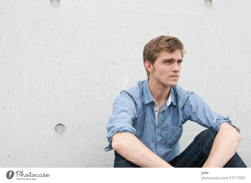 earnestness Calm Human being Young man Youth (Young adults) 18 - 30 years Adults Shirt Observe Sit Authentic Smart Reliability Secrecy Watchfulness