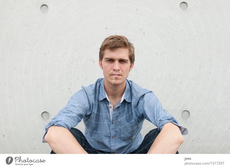 Serious Human being Young man Youth (Young adults) 18 - 30 years Adults Shirt Observe Sit Sharp-edged Reliability Town Secrecy Watchfulness Conscientiously