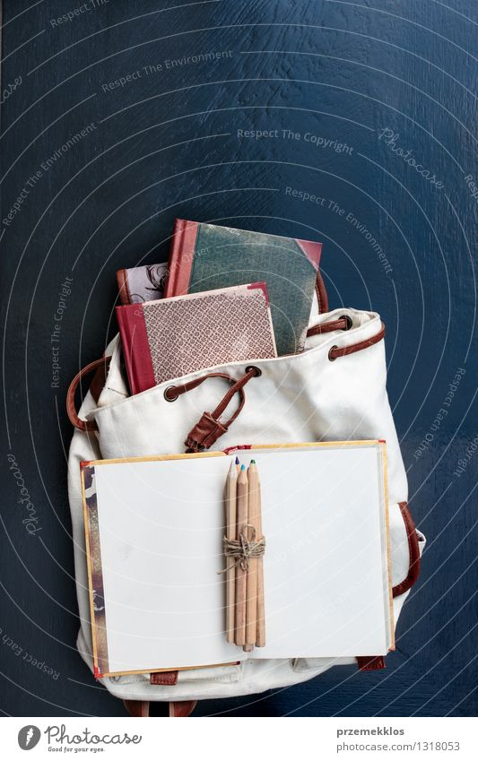 Notebooks pencils and school bag on a desktop Table School Study Book Accessory Education Backpack Crayon notebook Pencil Colour photo Interior shot Close-up
