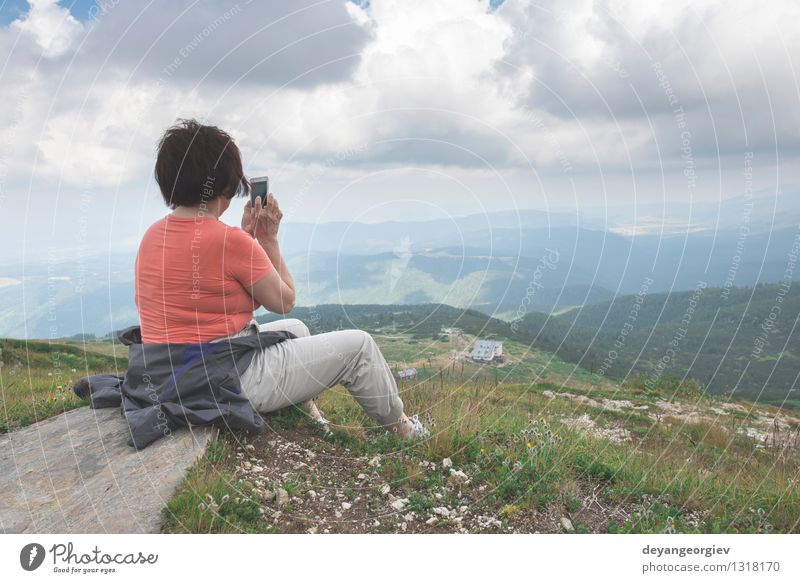 Senior woman taking photos with smartphone Lifestyle Beautiful Relaxation Mountain Retirement PDA Camera Human being Woman Adults Man Couple Nature Landscape
