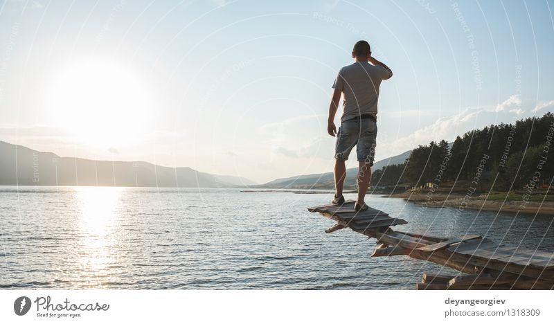Young adult in front of mountain lake Lifestyle Happy Beautiful Relaxation Leisure and hobbies Vacation & Travel Tourism Adventure Camping Summer Mountain