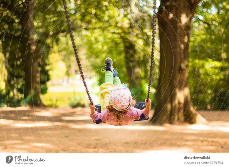 I'd better go swing! Playing To swing Child Girl Infancy 1 Human being 1 - 3 years Toddler Flying Happy Joy Contentment Swing Playground Colour photo