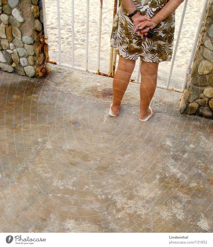 Any news? Stand Woman Shuffle Flip-flops Dress Flowery pattern Brown Sunbathing Grating Looking Lady Legs car keys Gate door