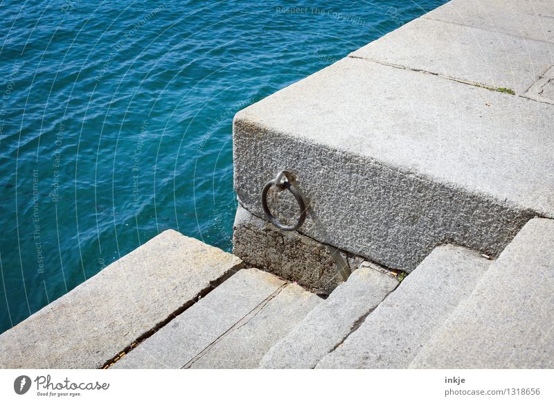 Neptune's door knocker Water Ocean Port City Deserted Harbour Wall (barrier) Wall (building) Stairs Navigation Jetty Stone Circle Level Simple Blue Colour photo