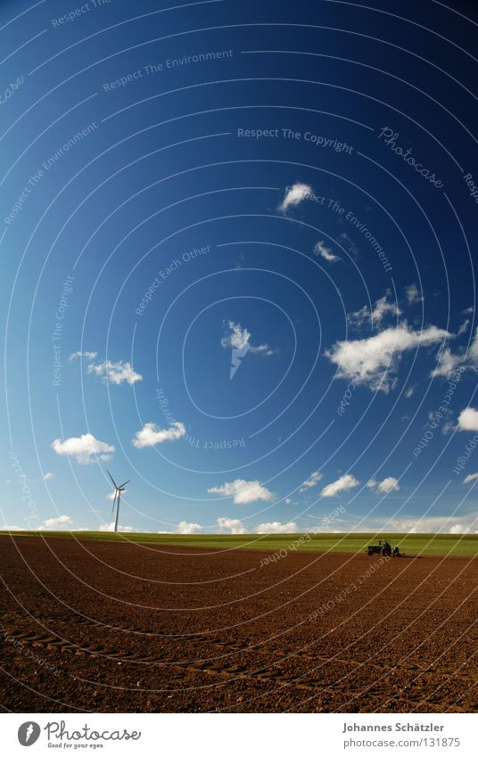 The farmer and the field Field Grass Agriculture Farmer Wind energy plant Science & Research Electricity Power Clouds Sky Spring Summer Sowing Tractor Cow dung