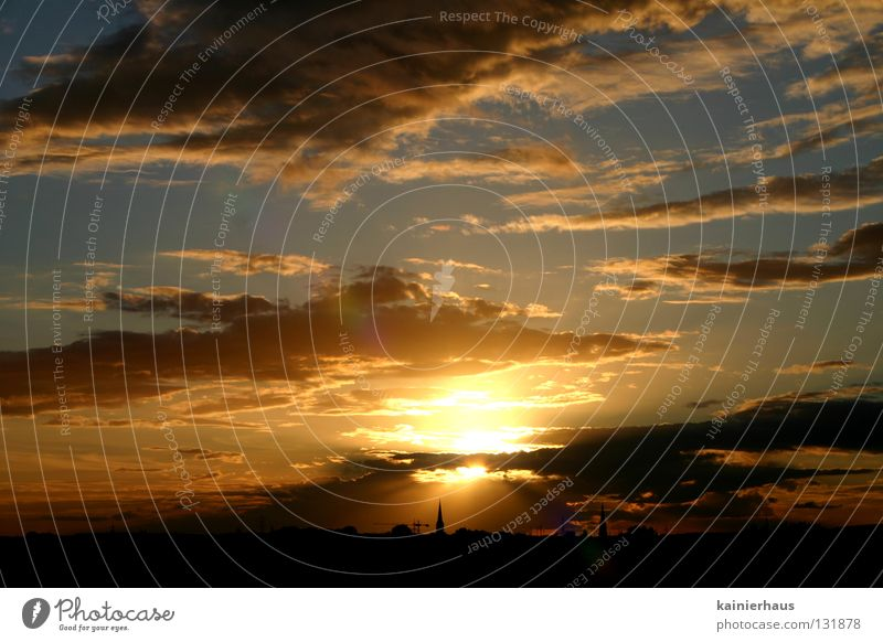 Contrast in Light Clouds Church spire Horizon Celestial bodies and the universe Sun Sky Religion and faith Blue