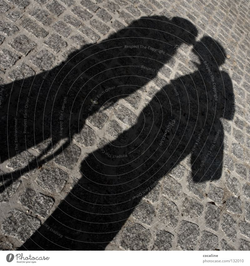 Interplay Shadow play Man Woman 2 Gray Black White Kissing Together Married Emotions Senses Welcome Dream Relationship Contentment Stone Street Couple Love