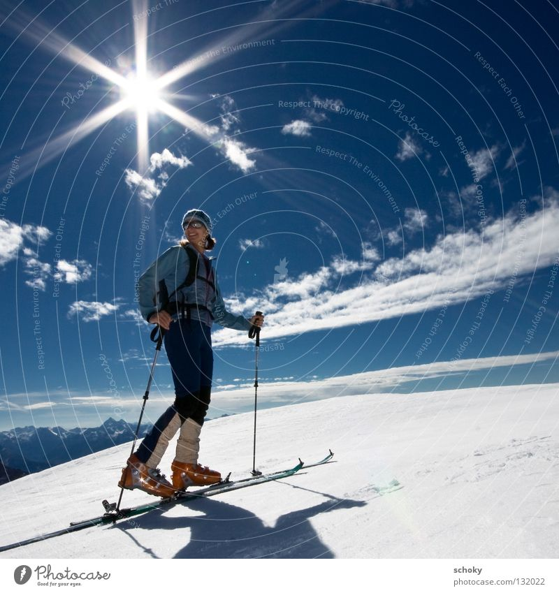 Woman Sky Blue White Vacation & Travel Sun Winter Joy Loneliness Far-off places Relaxation Cold Snow Sports Freedom Movement