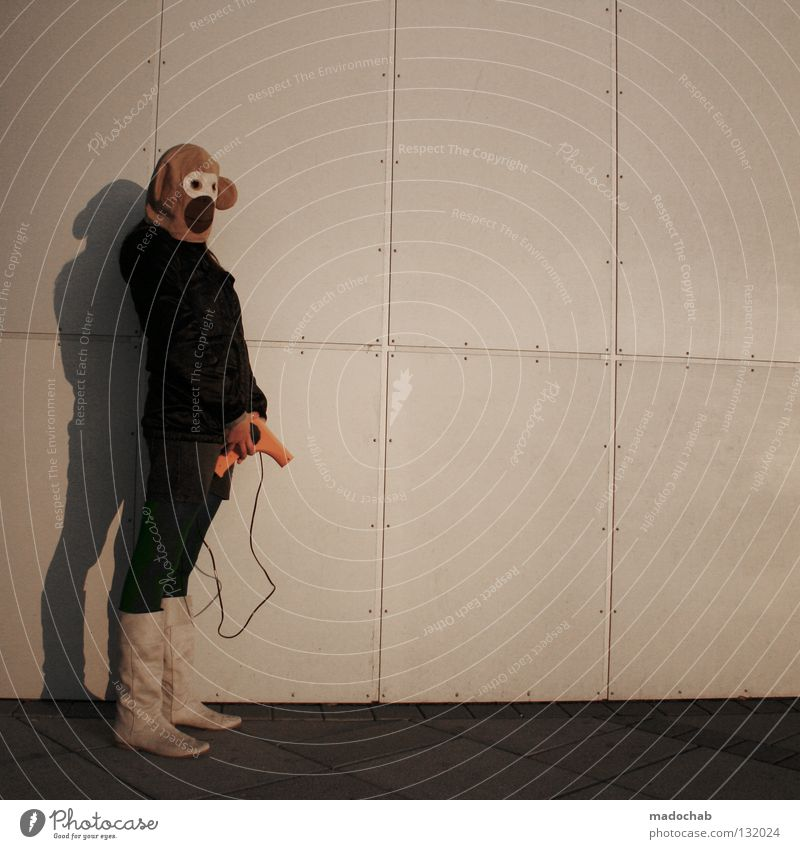 Woman Human being Wall (building) Emotions Wall (barrier) Exceptional Stand Lifestyle Clothing Mask Past Trashy Hide Boots Surrealism Monkeys