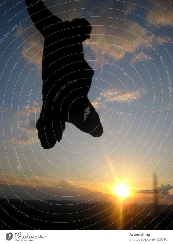 Human being Sky Man Sun Dark Landscape Playing Movement Jump Legs Bright Lighting Horizon Perspective Knee