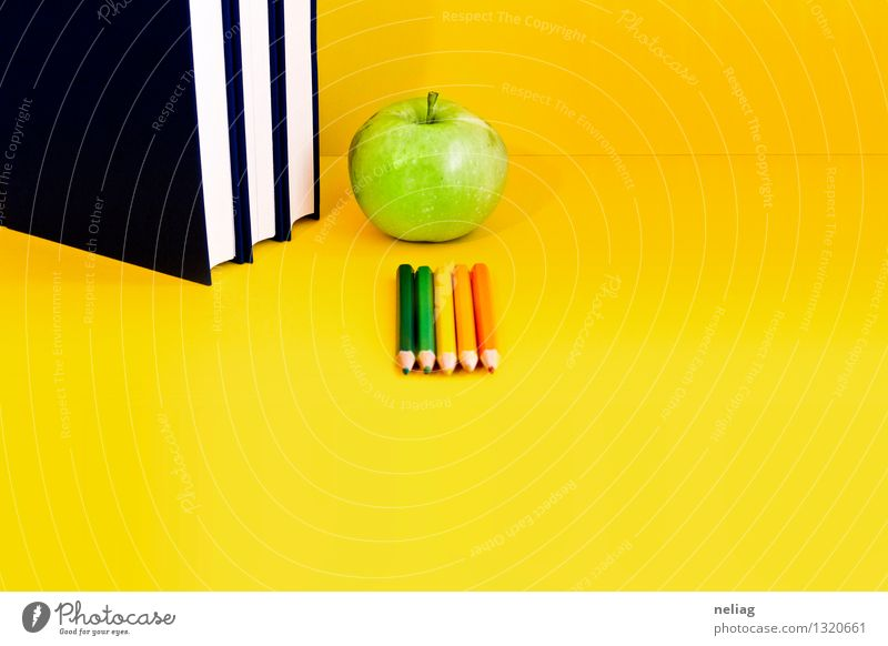 Books, green apple, colored crayons on bright yellow background Blue Green Calm Yellow School Food Orange Fruit Study Reading Curiosity Education
