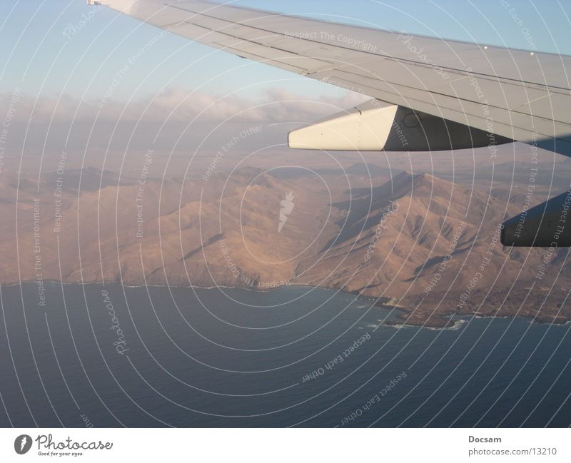 evaporated Airplane Fuerteventura Aerial photograph Ocean Wing Mountain Flying Boeing 737