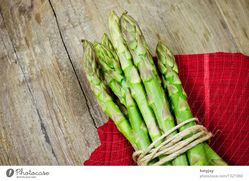 Green asparagus Asparagus Asparagus spears German Asparagus season Wooden table Wooden board Asperagus harvest Asparagus ends Bunch of asparagus Vegetable