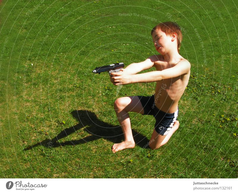 Bang, you're wet! Boy (child) Child Handgun Water pistol Toys Toy arms Playing Grass Meadow Summer Green Cowboy Shoot Weapon Strike rascals lousejunge