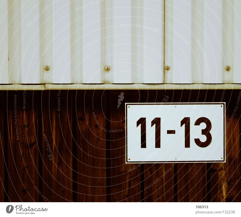 ELEVEN TO THREE TEN 3 10 13 11 Digits and numbers Wall (building) Corrugated sheet iron Dock House number by the time bonded screed typographical label