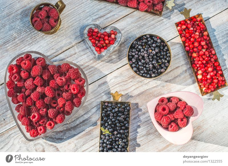 Red and black raspberry and blueberry Nature Blue Colour White Red Black Natural Fruit Fresh Berries Dessert Vitamin Vegetarian diet Juicy Strawberry Organic